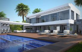Luxury houses for sale in Benitachell. New villa with pool and garden on the seafront in Cumbre del Sol, Costa Blanca