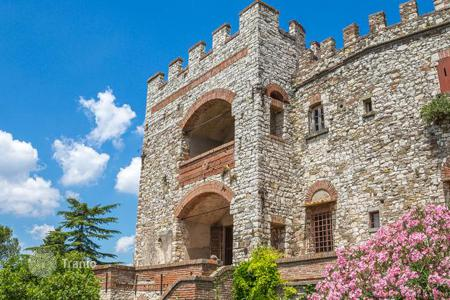 Chateaux for sale in Italy. Beautifully restored medieval castle with a plot of forest in Tuscany