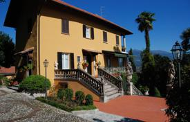 Luxury houses for sale in Italy. Ancient villa of the late XIX century, with its own park and a terrace overlooking Lake Maggiore in Baveno, Italy