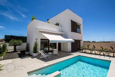 Cheap houses with pools for sale in Costa Blanca. Modern Detached Villa in La Marina Urbanization