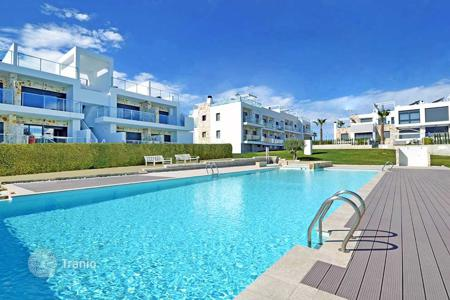 Cheap 3 bedroom apartments for sale in Costa Blanca. 3 bedroom apartment with garden very close to the beach in Punta Prima