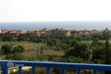 Cheap apartments with pools for sale in Chloraka. Charming sea view apartment in Chloraka, Paphos, Cyprus