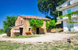 Property for sale in Marche. Country house to renovate with land and sea view