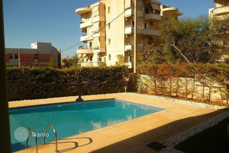 Apartments for sale in Greece. New apartments in a house with a swimming pool in the district of Ano Glyfada