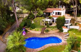 Luxury houses with pools for sale in Catalonia. Three-level villa with a pool, a garden and a children's playground in a quiet place, not far from the town of Lloret-de-Mar, Spain