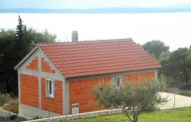 4 bedroom houses by the sea for sale in Split-Dalmatia County. Unfinished villa with a large plot and a sea view, Brac, Croatia