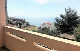Apartments with pools by the sea for sale in Croatia. Apartment with a loggia and a sea view in a house with a garage and a communal pool, Ciovo, Croatia