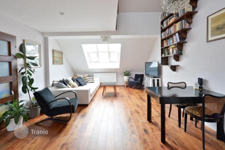 2 bedroom apartments for sale in Prague. Elegant duplex apartment with a view of the Strossmayer Square in the seventh district of Prague