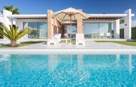Houses from developers for sale overseas. Luxury newly built villa in a high security urbanization in Cala Conta with sunset sea views, perfect for a family or friends summer rental