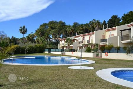 Residential for sale in Andalusia. Three-level townhouse in a residential complex with swimming pool, barbecue area and garden in Marbella, Golden Mile