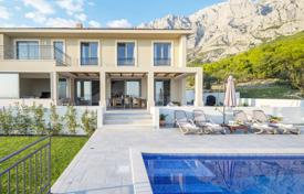 Houses for sale in Makarska. Two-storey villa with swimming pool, plot of land and sea view in Croatia, Makarska Riviera