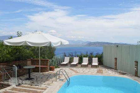 4 bedroom houses for sale in Kassiopi. LAND 800 SQ. M, BUILDING SIZE 180 SQ. M, WITH SWIMMING POOL AND SEA VIEW