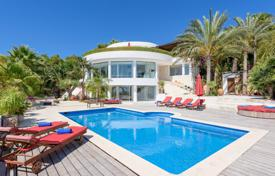 Luxury renovated villa with a panoramic view of Cala Tarida Bay, 500 metres from the beach, San Jose, Ibiza, Spain for 13,000 € per week