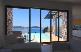 Houses with pools for sale in Rogoznica. Villa with a garden and a swimming pool, 25 meters from the beach, Zatoglav, Croatia