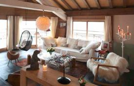 Houses for sale in Savoie. Luxury chalet with a terrace, a jacuzzi and mountain views, Courchevel, France