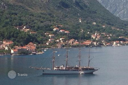 Apartments with pools by the sea for sale in Kindness. Apartment – Kindness, Kotor, Montenegro