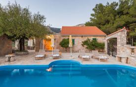 Houses with pools by the sea for sale in Split-Dalmatia County. Villa with a garden and a pool, 20 meters from the sea, Bol, Croatia