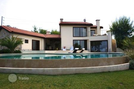 Luxury houses with pools for sale in Greece. Furnished villa with a private forest, a swimming pool and panoramic views, at 500 meters from the beach, Oropos, Greece