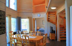 Property for sale in Finland. A wooden cottage with a spacious terrace, panoramic windows and a sauna, surrounded by a picturesque natural landscape, Jämsä, Finland