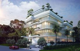 Townhouses for sale in North America. New townhouse with balconies, terraces on each level, a roof-top pool and garden in a gated residential complex, Bay Harbor Islands, USA