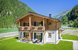 Houses from developers for sale in Alps. Two-level apartment with a garden near the mountain lake, Kaprun
