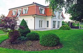 This luxury modern house and large garden is located in a beautiful natural environment only a few minutes drive from the centre of Celje for 1,350,000 €