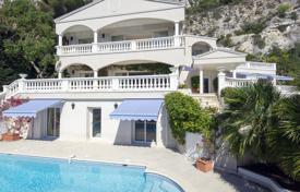 Houses with pools for sale in Cap d'Ail. Luxury villa with a pool, terraces and a library, in a private sector, 5 minutes from Monaco, Cap d'Ail, France