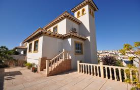 Houses with pools for sale in Costa Blanca. Two-level villa with a garage, a garden and a sea view in the residence with a pool, Playa Golf, Alicante
