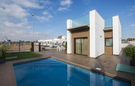 Villas and houses with pools for sale in Valencia. Modern villa with terrace, garden and swimming pool, in Ciudad Quesada, Spain