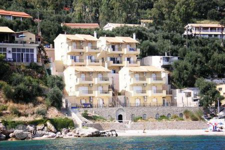 Houses with pools for sale in Corfu. CORFU. Beachfront house of 100sqm, on the beach and just 15km from Corfu town in a beautiful and quiet area is for sale. I