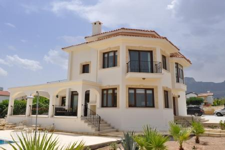 Coastal houses for sale in Cyprus. Luxury villa 500 meters from the sea and mountain views in a Çatalköy in the north of the island of Cyprus