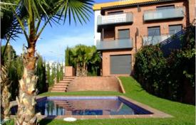 Coastal townhouses for sale in Catalonia. Modern house with an elevator, a garden and a terrace, in a new residence with a pool, near the beach, in the seaside town of Sitges, Spain
