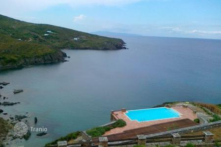 Villas and houses for rent with swimming pools in Aegean. This brilliant new villa is located above a small secluded beach on the majestic island of Andros. The sea front villa stands grac