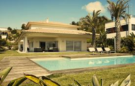 Luxury residential for sale in Costa del Garraf. Two-storey villa with a pool and views of the golf course, Sitges, Spain