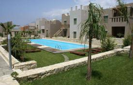 Apartments with pools for sale in Rethimnon. Apartment with a terrace in a new residential complex with a pool, spa, a restaurant, a tennis court and other amenities, Rethymnon, Greece