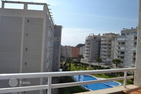 Apartments with pools by the sea for sale in Benidorm. Two bedroom apartment with a terrace 400 meters from the beach in Benidorm, Alicante, Spain