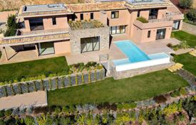 Houses with pools for sale in Saint-Tropez. New two-level villa with a garden, a pool and sea views in Cote d'Azur, France