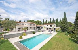 Luxury houses with pools for sale in Mougins. Modern villa with a view of the bay, an independent apartment, a pool, a tennis court and a cinema, in a quiet district, Mougins, France