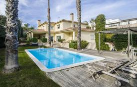 Houses with pools for sale in Alella. Modern villa with a garden, terraces and a swimming pool, near the beach, Alella, Spain
