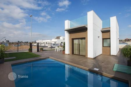 Houses for sale in Valencia. Modern villa with terrace, garden and swimming pool, in Ciudad Quesada, Spain