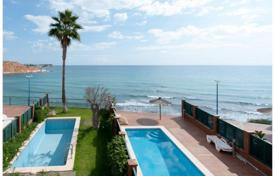 Houses with pools for sale in Costa Blanca. Sea view villa with solarium, terrace and swimming pool, near the beach, in Alicante, Spain