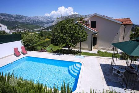 Apartments for sale in Dalmatia. Villa with pool and garden in a quiet area, surrounded by nature in Split, Croatia