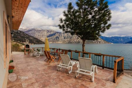 3 bedroom houses by the sea for sale in Kotor. Beautiful three bedroom house in Strp. Sea front property with stunning sea views! Easy walk down to the beach, own deck in the sea