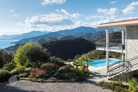 Luxury houses with pools for sale in Ventimiglia. Stylish villa with a panoramic view of the coast and a large plot with a swimming pool and a barbecue area, Ventimiglia, Italy