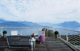 Townhouses for sale in Italy. Designer apartment with private garden, terrace and panoramic views of the lake Maggiore in Stresa, Italy