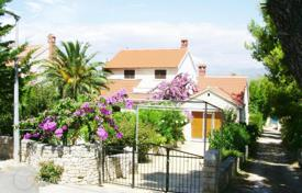 Coastal houses for sale in Split-Dalmatia County. Spacious villa with a private garden, a garage, a mooring and a sea view, Brac, Croatia
