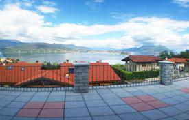 Apartments for sale in Italy. New duplex apartment with private garden, garage and terrace with panoramic views of Lake Maggiore, Piemonte, Italy