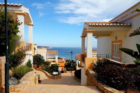Townhouses for sale in Portugal. Townhouse with terrace and garden in a new residential complex in 500 meters from the beach of Salema, Algarve, Portugal