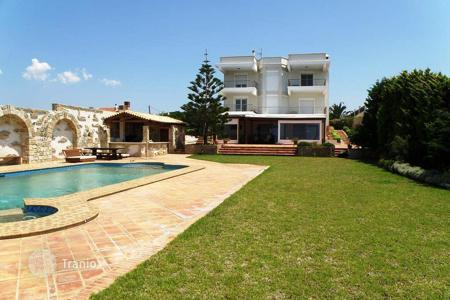 Luxury houses with pools for sale in Peloponnese. Three-storey villa with a descent to the beach in the Peloponnese