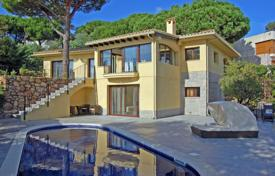 Luxury 4 bedroom houses for sale in Costa Brava. Two-storey villa with a pool, a balcony and a garden, overlooking the sea, 350 meters from the beach, Lloret de Mar, Spain